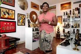Neneh Baggiani, owner of Out of Africa Art Shop, in her new store in the Villas on Antique Row The shop carries original and authentic African and Moroccan art. (Bill Ingram/Palm Beach Post)
